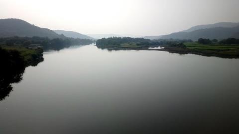 Train travel throu India 1. Beautiful misty river Footage
