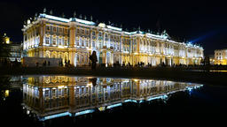 Impressive Winter Palace building illuminated at night, clear reflection Footage