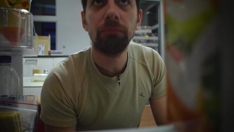 man looks in the fridge Stock Video Footage