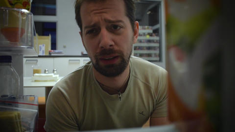man looks in the fridge Footage