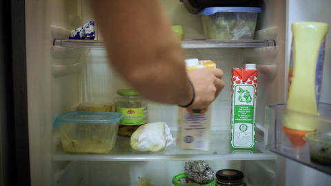man looks in the fridge Live Action