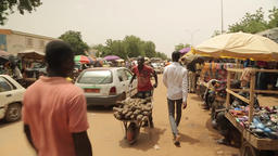 Niger, Africa. July 2013. Walking through a street scene in the marketplace Footage
