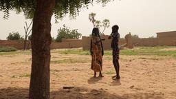 Niger, Africa. July 2013. Muslim woman walking in a traditional desert village Footage