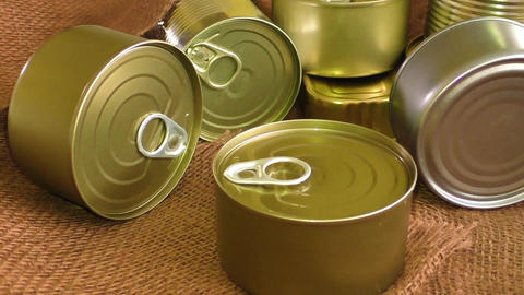 Closed metal tin cans on brown background Footage