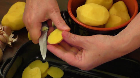 Sliced raw potatoes – cooking Live Action