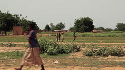 Niger, Africa. July 2013.Women working and carrying goods on their heads Footage