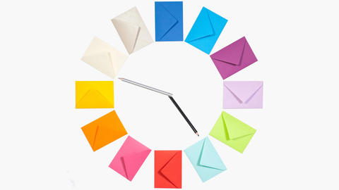 Clock of twelve colored letter envelopes for Christmas mailing Footage
