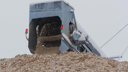 Wood chips coming out of a wood chipper at paper mill Footage