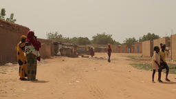 Niger, Africa. July 2013. African women with children in a village by the countr Footage