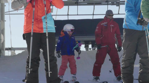 Skiers who came with chairlift on the piste and is now preparing to descend the  Footage