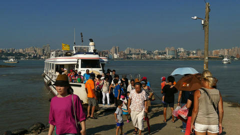 People leave ferry at Tamsui skyline Footage