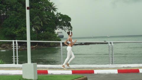 Athletic Woman Running On Promenade Near Ocean Footage