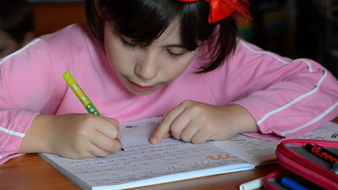 Girl who homework they received at school on the kitchen table 02 Footage