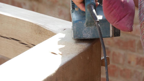Detail of a worker who process wood with a sander belt sander 74 Footage