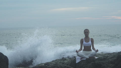 Woman In Yoga Lotus Meditation Position Front To Seaside Footage