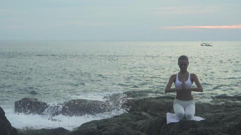 Girl Doing Yoga Exercises On The Sea Coast Footage