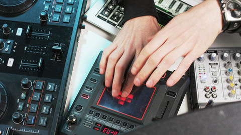 Disc Jockey's Hands Visible While He Changes Settings of the Sound Control Syste Footage