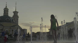 People in the fountain at sunset. Timelapse Footage