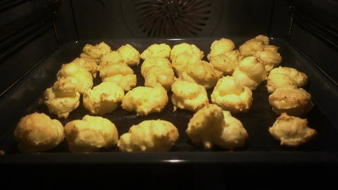 Cream puffs baking in the Oven. Time lapse Footage