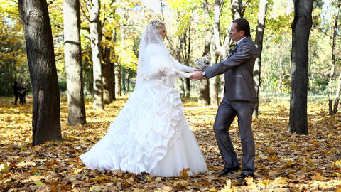Wedding couple dances in the autumn park Footage