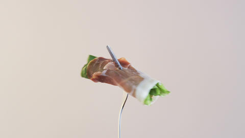 Fork With Ham and Lettuce on Almond Background Footage