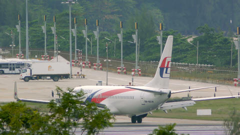 Aircraft of Malaysia Airlines turn from runway to taxiway Footage