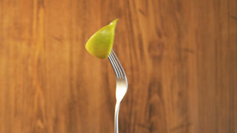 Fork With Lemon on Wooden Background Footage