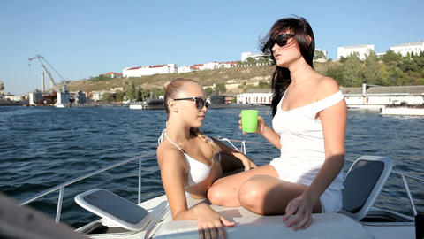 Young woman relaxing on a yacht ビデオ