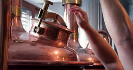 Craft brewery equipment 4k close-up video. Beer brew production: close vats tank Footage
