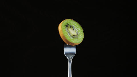 Fork With Kiwi on Black Background Stock Video Footage
