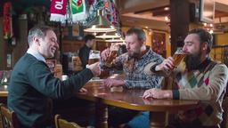 Male friend drinks beer pub bar HD slow-motion video. Men tasting enjoying lager Footage