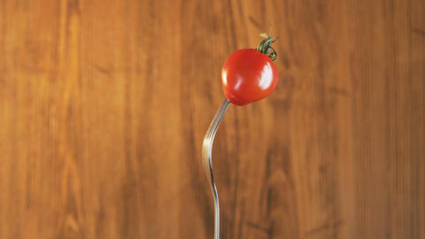 Fork With Tomato on Wooden Background Live Action