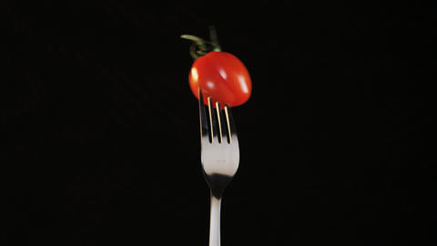 Fork With Tomato on Black Background Footage