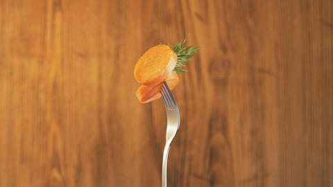 Fork With Carrot on Wooden Background Stock Video Footage