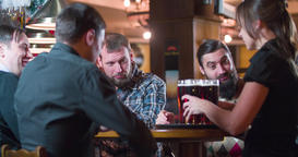 Waiter brings beer glasses for men 4k video on pub bar. Toast cheers drinks fun Footage