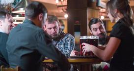 Waiter brings beer glasses for men 4k video on pub bar. Toast cheers drinks fun Footage