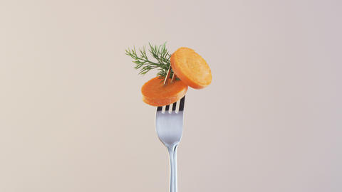Fork With Carrot on Almond Background Footage