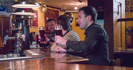 Friends talks drinks beer pub bar 4k video. Men toast cheers lager or ale Footage