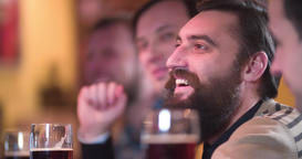 Friends talks drinks beer pub bar 4k close-up video. Men toast cheers fun Footage