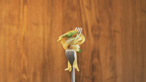 Fork With Spaghetti and Parsley on Wooden Background Footage