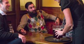 Waiter brings beer glasses for men 4k video on pub, bar or restaurant. Toast Footage