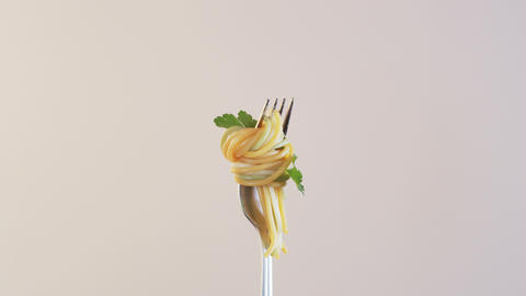 Fork With Spaghetti and Parsley on Almond Background ビデオ