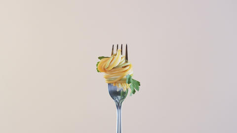 Fork With Spaghetti and Parsley on Almond Background Footage