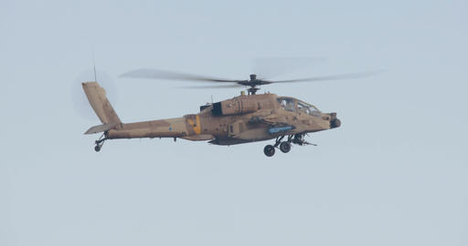 Military helicopter performing combat maneuvers during an airshow Image