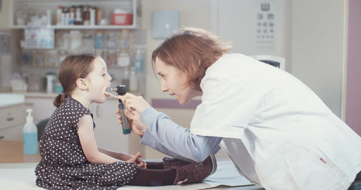 Female doctor checking a young girl in the hospital Live Action