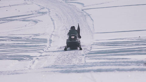Snowmobile riding on sidewalk Filmmaterial
