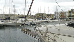Yachts moored at Msida Marina in Malta. Sail boats in a row on docks at seaside  Footage