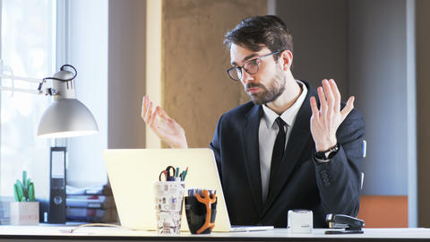Young Businessman Explaining Something During Videoconference Footage