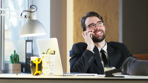 Young Businessman Happy While Talking on the Phone Footage