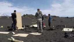 Build of field toilets for tourists on volcanic slag field on Kamchatka Footage